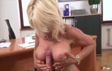 Giant-tits secretary devouring a hard cock