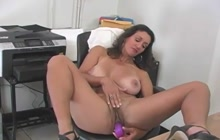 Big boobed secretary toying her pussy in the office